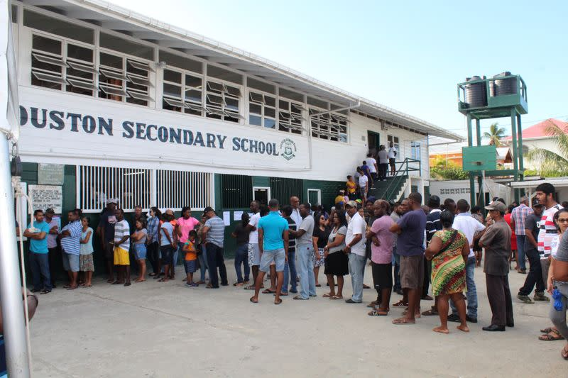 FILE PHOTO:  People queue to vote in Guyana's presidential elections in Georgetown