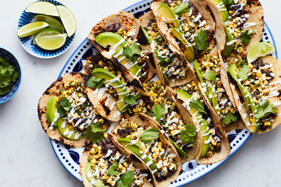 "Ripe summer corn is so delicious, so fresh, and so full of flavor, you can enjoy it raw. Filled with black beans, avocado, and raw corn marinated in bright lime juice along with jalapeño, cilantro, and toasted nuts and seeds, these hearty tacos make an easy to cook, easy to eat 4th of July main. <a href=""https://www.epicurious.com/recipes/food/views/spicy-black-bean-and-corn-tacos?mbid=synd_yahoo_rss"" rel=""nofollow noopener"" target=""_blank"" data-ylk=""slk:See recipe."" class=""link rapid-noclick-resp"">See recipe.</a>"