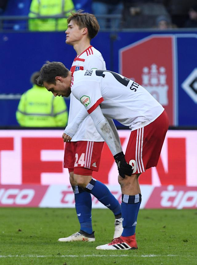 Soccer Football - Bundesliga - Hamburger SV vs Hertha BSC - Volksparkstadion, Hamburg, Germany - March 17, 2018 Hamburg's Gotoku Sakai and Matti Steinmann react REUTERS/Fabian Bimmer DFL RULES TO LIMIT THE ONLINE USAGE DURING MATCH TIME TO 15 PICTURES PER GAME. IMAGE SEQUENCES TO SIMULATE VIDEO IS NOT ALLOWED AT ANY TIME. FOR FURTHER QUERIES PLEASE CONTACT DFL DIRECTLY AT + 49 69 650050