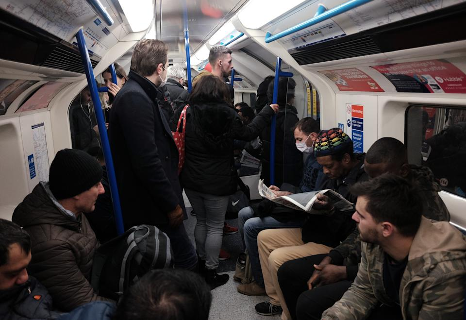 A packed carriage full of passengers travelling on the Victoria line of the London Underground tube network, after Boris Johnson ordered pubs and restaurants across the country to close tonight as the Government announced unprecedented measures to cover the wages of workers who would otherwise lose their jobs due to the coronavirus outbreak.