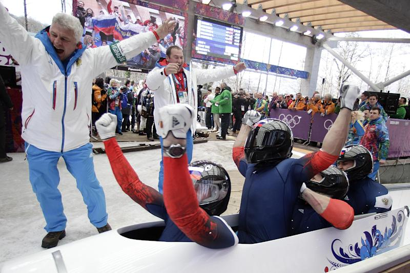 The team from Russia RUS-1, with Alexander Zubkov, Alexey Negodaylo, Dmitry Trunenkov, and Alexey Voevoda, celebrate after they won the gold medal during the men's four-man bobsled competition final at the 2014 Winter Olympics, Sunday, Feb. 23, 2014, in Krasnaya Polyana, Russia. (AP Photo/Jae C. Hong)
