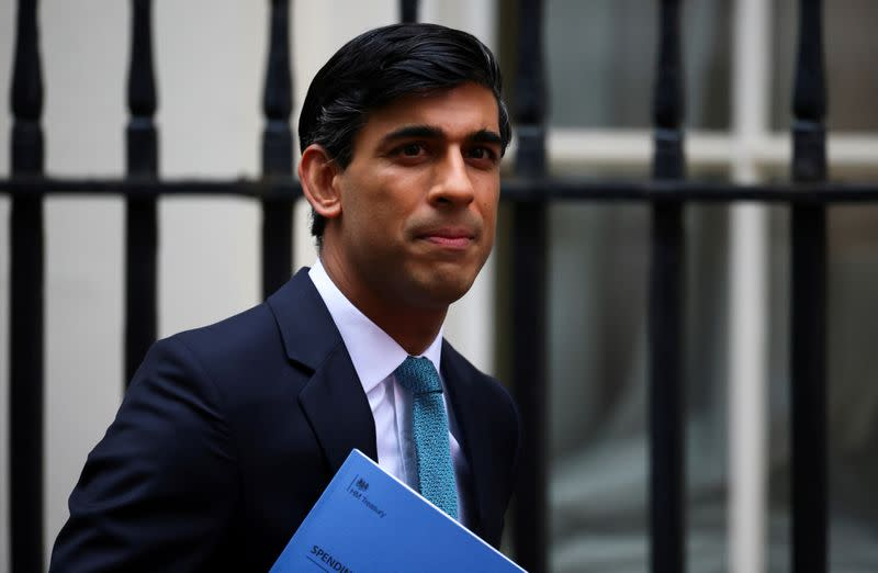 FILE PHOTO: Britain's Chancellor of the Exchequer Sunak outside Downing Street, in London