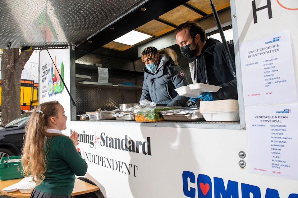 Footballer Reece James joined Evgeny Lebedev to volunteer for the Independent and Evening Standard Food for London Now campaign (Lucy Young)