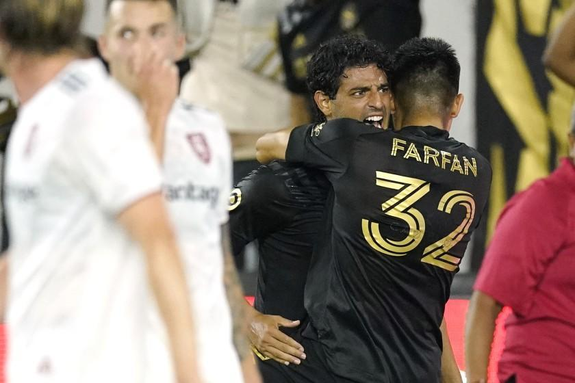 LAFC's Carlos Vela, second from right, celebrates his 79th-minute goal with defender Marco Farfan on July 17, 2021.