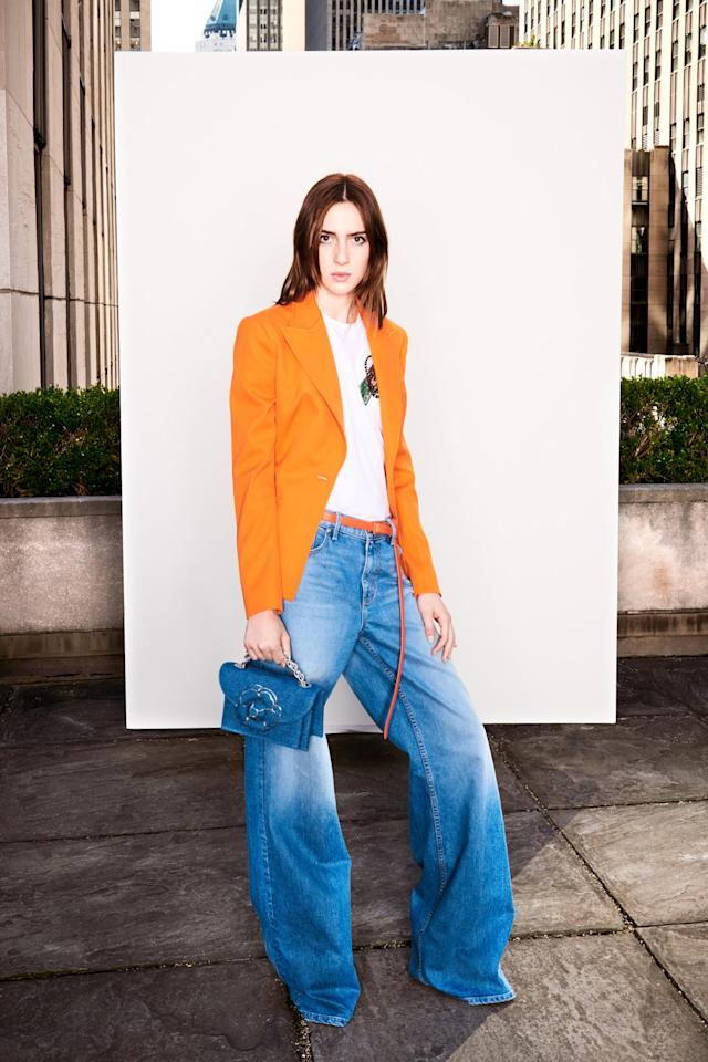 <p>A model in a mandarin wool gabardine blazer with wide leg jeans. (Photo: Courtesy of Oscar de la Renta) </p>