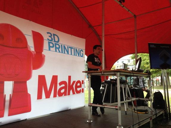 Made in Space co-founder and chief strategy officer Mike Chen discusses his company's 3D printer, which is launching to the International Space Station in 2014, with an audience at the 2013 World Maker Faire at the New York Hall of Science in N