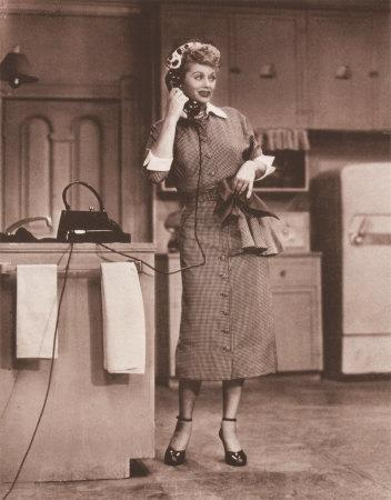 """<div class=""""caption-credit""""> Photo by: CBS</div><b>Lucy Ricardo on """"I Love Lucy""""</b> <br> From her checkered collared dresses to her head scarves, we love Lucy and her unique sense of style. Her outfits were always just the right amount of feminine to balance out her wacky faces and slapstick comedy."""