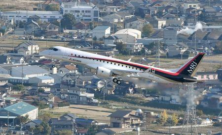 An aerial view shows Mitsubishi Aircraft Corp's Mitsubishi Regional Jet (MRJ) taking off for a test flight at Nagoya Airfield in Toyoyama town, Aichi Prefecture, central Japan, in this photo released by Kyodo November 11, 2015. Mandatory credit REUTERS/Kyodo