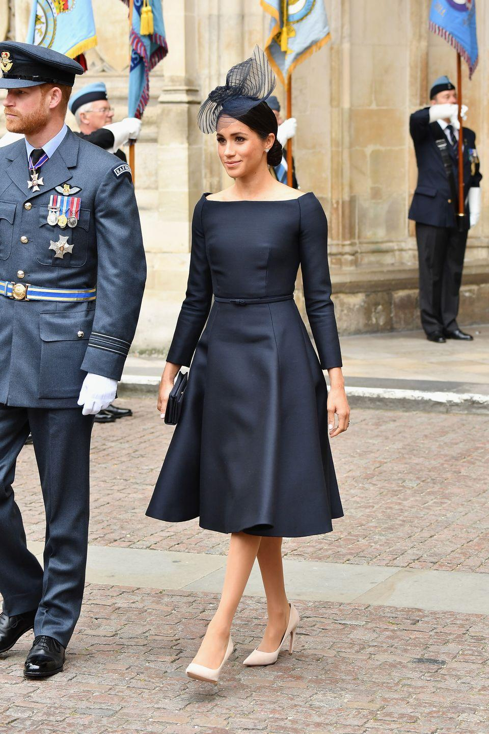 "<p><span class=""redactor-unlink"">Meghan channeled </span><a href=""https://www.townandcountrymag.com/style/fashion-trends/a22095663/meghan-markle-raf-100-anniversary/"" rel=""nofollow noopener"" target=""_blank"" data-ylk=""slk:Audrey Hepburn in honor of the Royal Air Force's 100th anniversary."" class=""link rapid-noclick-resp"">Audrey Hepburn in honor of the Royal Air Force's 100th anniversary.</a> <span class=""redactor-unlink"">The Duchess wore a bespoke Dior A-line dress</span> with a boatneck (just like her wedding dress!) with a matching Stephen Jones hat. Meghan also wore a pair of Cartier earrings. </p>"