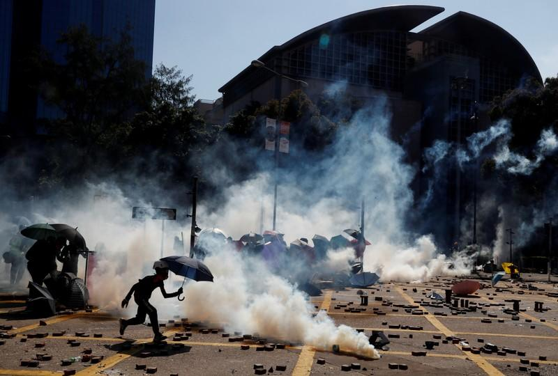 FILE PHOTO: Protesters clash with police outside Hong Kong Polytechnic University (PolyU) in Hong Kong