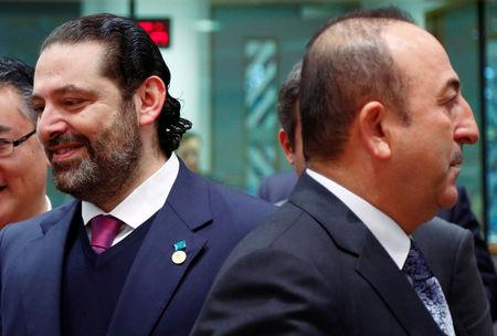 Lebanese Prime Minister Saad Al-Hariri and Turkish Foreign Minister Mevlut Cavusoglu attend an international peace and donor conference for Syria, at the European Union Council in Brussels, Belgium March 14, 2019.  REUTERS/Francois Lenoir