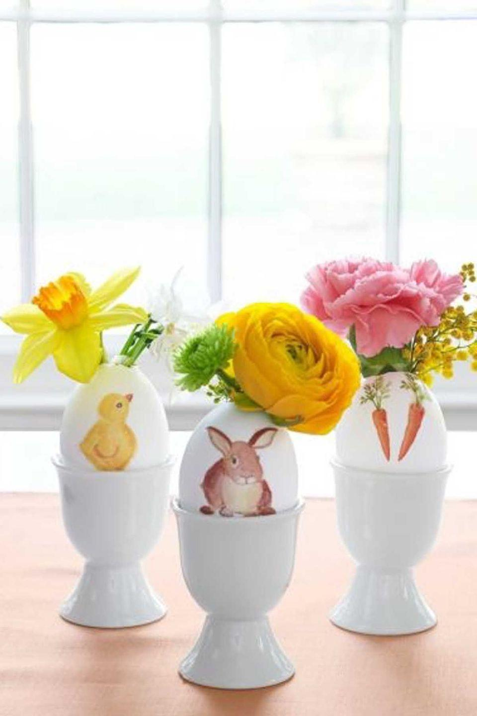 """<p>Download our <a href=""""http://wdy.h-cdn.co/assets/downloads/1456243733_-_wd-easter-watercolor-images.pdf"""" rel=""""nofollow noopener"""" target=""""_blank"""" data-ylk=""""slk:watercolor images template"""" class=""""link rapid-noclick-resp"""">watercolor images template</a>, and print onto Grafix Rub-Onz Transfer Film. Tip: You may need to select the photo paper setting on your printer. Follow package instructions to transform images into adhesive decals, then apply to eggs by rubbing with your fingers or the flat end of a wine cork.</p><p><strong><a class=""""link rapid-noclick-resp"""" href=""""https://www.amazon.com/Grafix-Adhesive-2-Inch-11-Inch-6-Pack/dp/B000S15KDS/?tag=syn-yahoo-20&ascsubtag=%5Bartid%7C10070.g.1751%5Bsrc%7Cyahoo-us"""" rel=""""nofollow noopener"""" target=""""_blank"""" data-ylk=""""slk:SHOP ADHESIVE FILM"""">SHOP ADHESIVE FILM</a></strong></p>"""