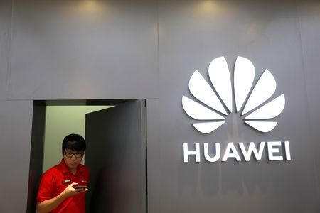 A staff uses a phone as he works at Huawei Flagship Store in Bangkok, Thailand May 23, 2019. REUTERS/Soe Zeya Tun