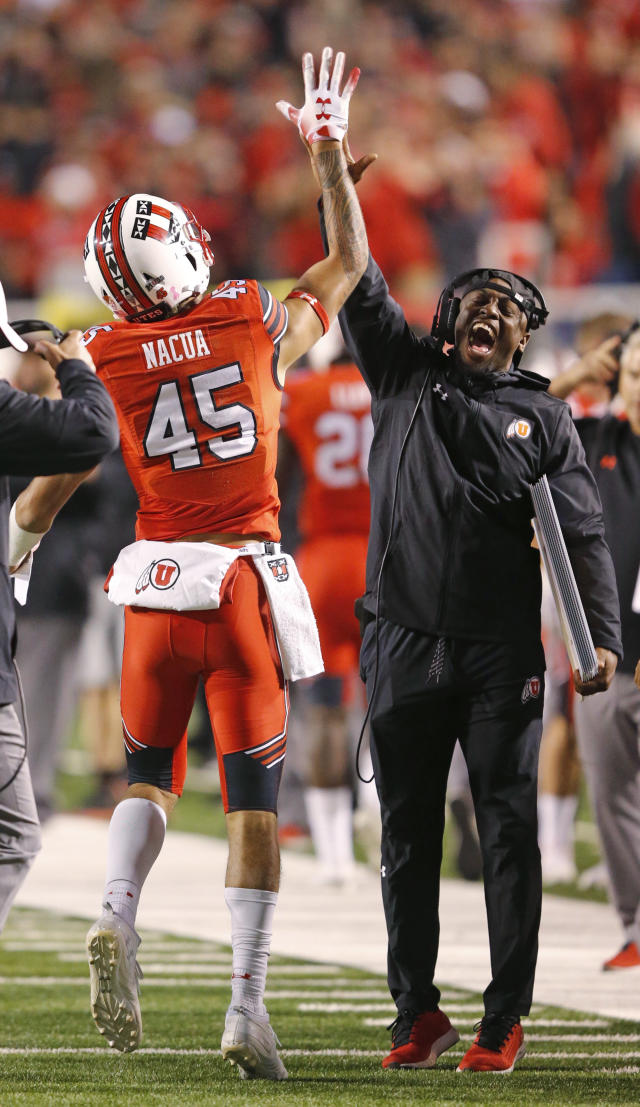 Utah wide receiver Samson Nacua (45) receives a high-five after scoring against Arizona during the first half of an NCAA college football game Friday, Oct. 12, 2018, in Salt Lake City. (AP Photo/Rick Bowmer)