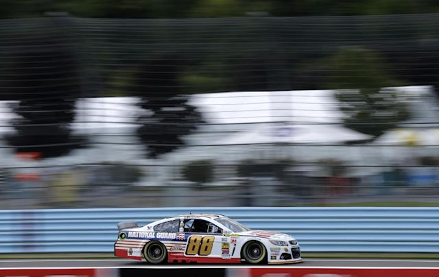 Dale Earnhardt Jr. (88) drives during a practice session for Sunday's NASCAR Sprint Cup Series auto race at Watkins Glen International, Friday, Aug. 8, 2014, in Watkins Glen N.Y. (AP Photo/Mel Evans)