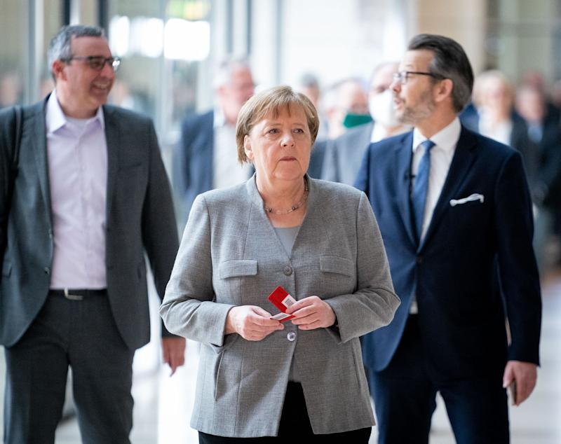 14 May 2020, Berlin: Chancellor Angela Merkel stands in a queue at the Bundestag session for a roll-call vote. Topics of the 160th session include the adoption of a law on further corona measures in the health care system, the adoption of a law to increase short-time work compensation and ESM credit lines for corona assistance in the euro zone. Photo: Kay Nietfeld/dpa (Photo by Kay Nietfeld/picture alliance via Getty Images)