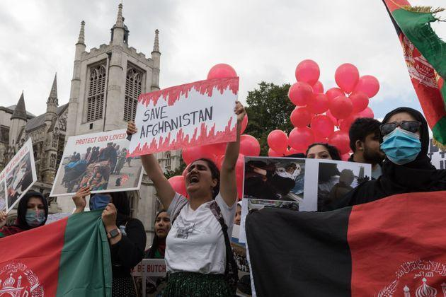 Demonstrators protest in Parliament Square against Taliban and demand human rights in Afghanistan as MPs hold a debate on the crisis. (Photo: Barcroft Media via Getty Images)