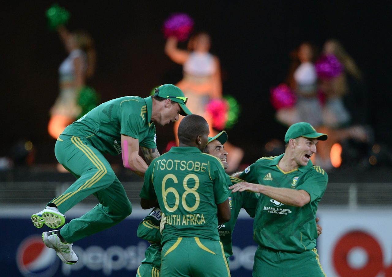 South African cricketers celebrate after taking a wicket of Pakistani batsman Sohaib Maqsood (unseen) during the second and last cricket T20 International at Dubai stadium on November 15, 2013 in Dubai. South Africa sparked another Pakistan batting collapse to win the second Twenty20 international by six runs, taking the two-match series 2-0. AFP PHOTO/ Asif HASSAN        (Photo credit should read ASIF HASSAN/AFP/Getty Images)