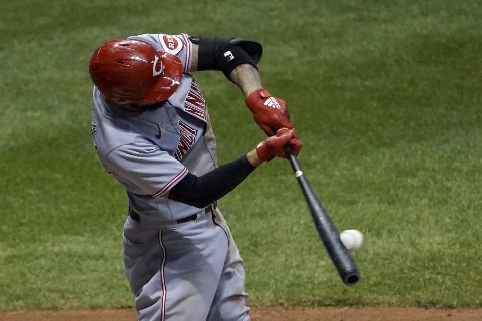 Cincinnati Reds' Nicholas Castellanos hits a two-run home run during the sixth inning of a baseball game against the Milwaukee Brewers Friday, Aug. 7, 2020, in Milwaukee. (AP Photo/Morry Gash)