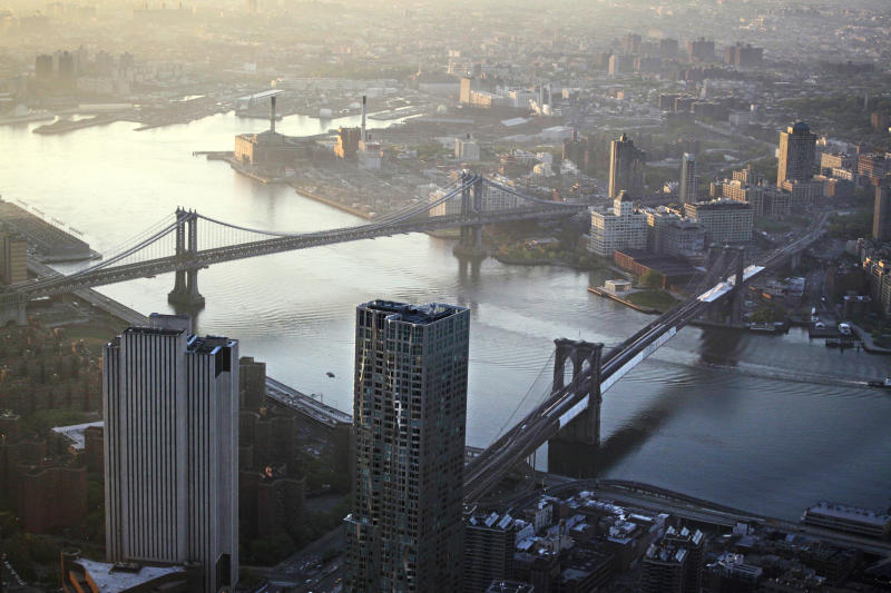 FILE - This file photo of May 10, 2013 shows view of the Manhattan Bridge, left, and Brooklyn Bridge as seen from the 105th floor of One World Trade Center, in New York. Seven months after Superstorm Sandy swamped New York, Mayor Michael Bloomberg proposed a nearly $20 billion plan Tuesday, June 11, 2013, to protect the city from the effects of global warming and storms. (AP photo/Mark Lennihan, File)