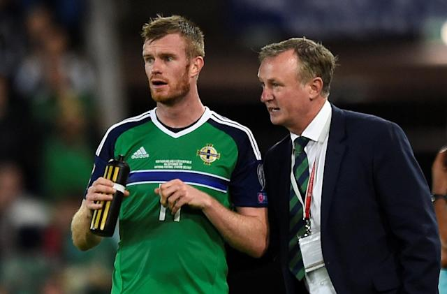 Soccer Football - 2018 World Cup Qualifications - Europe - Northern Ireland vs Czech Republic - Belfast, Britain - September 4, 2017 Northern Ireland manager Michael O'Neill speaks to Chris Brunt during the game REUTERS/Clodagh Kilcoyne
