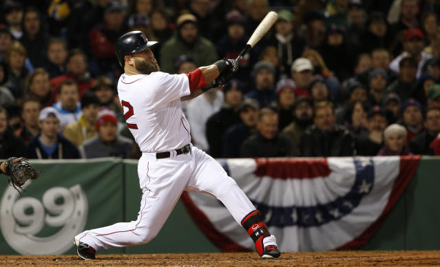 Boston Red Sox's Mike Napoli follows through on a three-run home run against the Milwaukee Brewers during the third inning of a baseball game at Fenway Park in Boston, Saturday, April 5, 2014. (AP Photo/Winslow Townson)