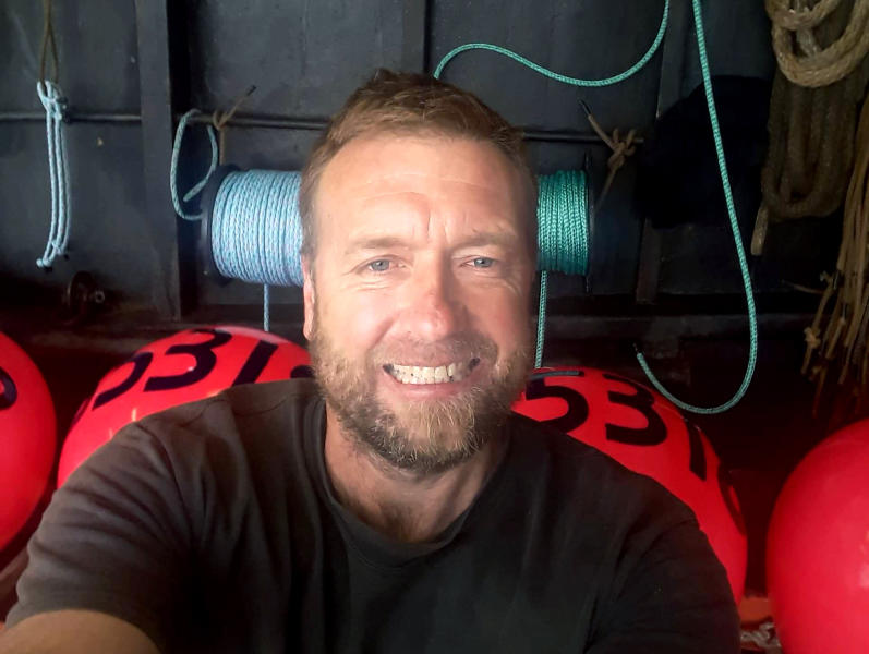 In this photo provided by Ashley Boggs, Boggs' fiance Brock Rainey, a crew member on the Scandies Rose, smiles in a selfie. The U.S. Coast Guard has called off the search for five crew members, including Rainey, of the crab fishing vessel that sank New Year's Eve off Alaska. The decision came after the service said it had exhausted all leads and considered the chances for survival. (Brock Rainey/Courtesy of Ashley Boggs via AP)