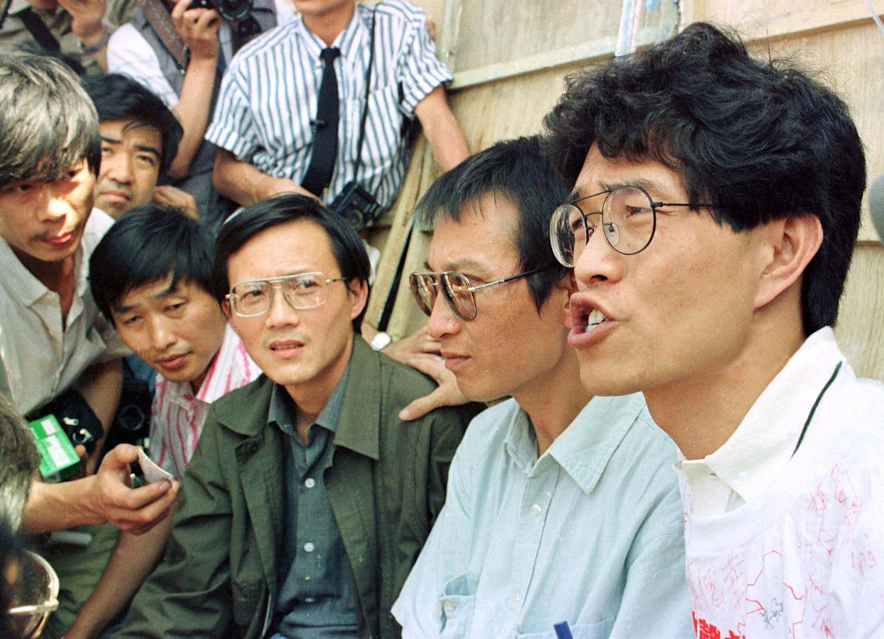 REFILE - ADDING POSITIONS - FILE PHOTO - Liu Xiaobo (2nd R), Hou Dejian (R), Zhou Duo (2nd L) and Gao Xin (L) talk to journalists in front of the Monument to People's Heroes before beginning their hunger strike in Beijing, China June 2, 1989. REUTERS/File Photo