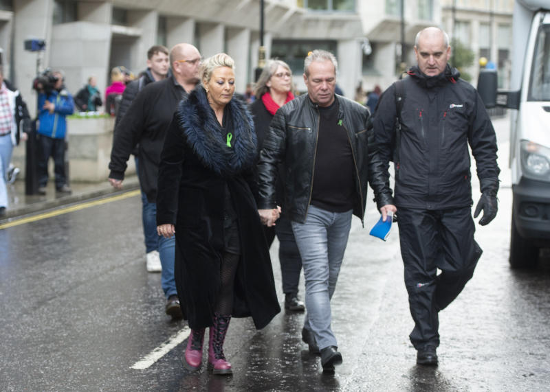Harry Dunn mother Charlotte Charles (left) and stepfather Bruce Charles (centre) outside the Ministry Of Justice in London after meeting with the Director of Public Prosecutions. Anne Sacoolas has been charged with causing death by dangerous driving after the car she was driving allegedly collided with 19-year-old Harry's motorbike outside RAF Croughton in Northamptonshire on August 27.