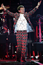 <p>Dressed up like the most handsome jester you've ever seen, Harry wore this wild Gucci outfit while performing at the iHeartRadio Music Festival in Las Vegas. One million extra points for the see-through shirt so we can see his ICONIQUE butterfly tatt.</p>