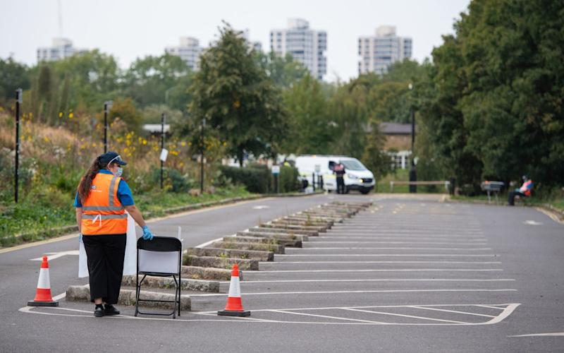 Staff wait for visitors at a test site in Southwark, south London - PA