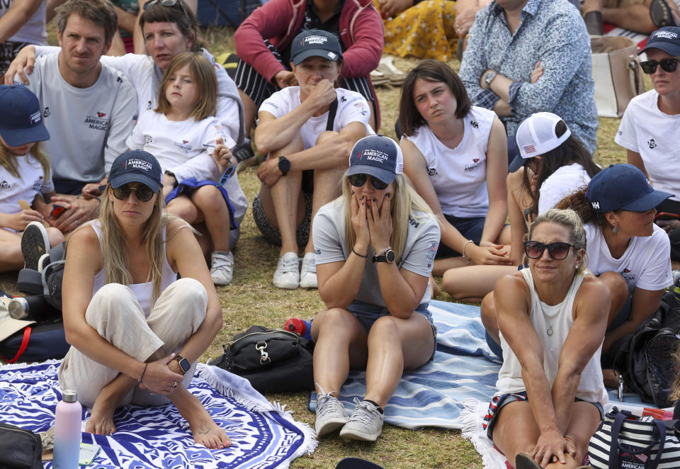 Supporters of the New York Yacht Club react as they watch American Magic race Italy's Luna Rossa in the America's Cup challenger series semifinals on Auckland's Waitemate Harbour, New Zealand, Saturday, Jan. 30, 2021. (Brett Phibbs/NZ Herald via AP)
