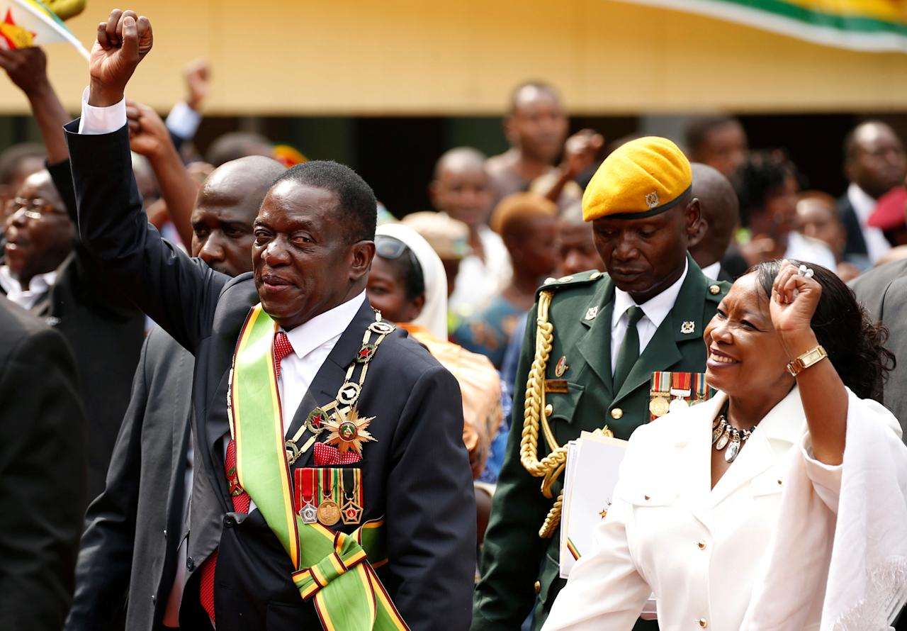 <p>Zimbabwe's new president Emmerson Mnangagwa and his wife Auxillia wave to their suppoters as they leave after the swearing in ceremony in Harare, Zimbabwe, Nov. 24, 2017. (Photo: Siphiwe Sibeko/Reuters) </p>