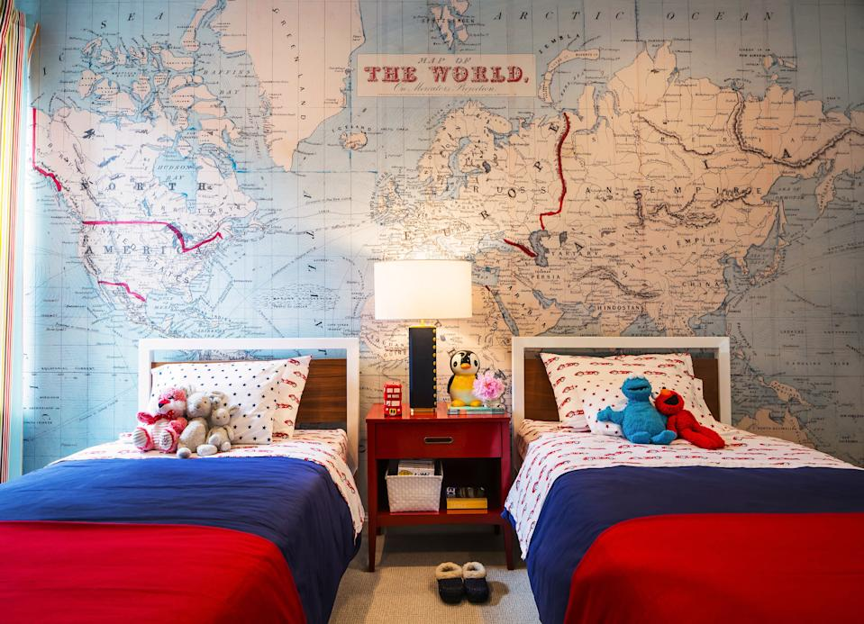"""<div class=""""caption""""> The color inspiration for one of the boy's bedrooms is the floor-to-ceiling wall mural from <a href=""""https://www.wayfair.com/brand/bnd/swag-paper-b37228.html"""" rel=""""nofollow noopener"""" target=""""_blank"""" data-ylk=""""slk:Swag Paper"""" class=""""link rapid-noclick-resp"""">Swag Paper</a>. The beds are from <a href=""""https://www.roomandboard.com/"""" rel=""""nofollow noopener"""" target=""""_blank"""" data-ylk=""""slk:Room & Board"""" class=""""link rapid-noclick-resp"""">Room & Board</a>, the linens are <a href=""""https://www.williams-sonoma.com/pages/williams-sonoma-home/"""" rel=""""nofollow noopener"""" target=""""_blank"""" data-ylk=""""slk:Williams Sonoma Home"""" class=""""link rapid-noclick-resp"""">Williams Sonoma Home</a>, and the bedside table is a vintage piece with a custom lacquer. </div>"""