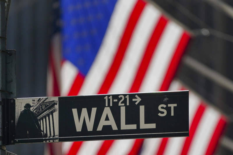 The American Flag hangs outside the New York Stock Exchange Wednesday, Oct. 14, 2020, in New York. Stocks are opening lower on Wall Street, putting the market on track for its third straight loss this week. The S&P 500 gave up 0.9% in early trading Thursday. (AP Photo/Frank Franklin II)