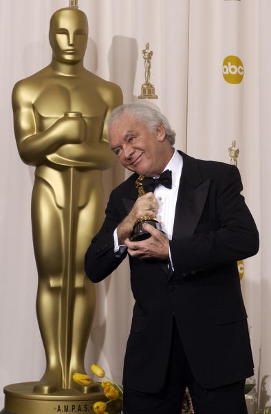 "In this Sunday, March 23, 2003 photo, producer Martin Richards embraces his Oscar statue after the film ""Chicago"" won for best motion picture of the year at the 75th annual Academy Awards in Los Angeles. Richards, the Tony Award-winning producer behind such Broadway hits as ""Sweeney Todd,"" and ""The Will Rogers Follies,"" has died, his publicist said Tuesday, Nov. 27, 2012. He was 80. Publicist Judy Jacksina said Richards died Monday. (AP Photo/Mark J. Terrill)"