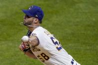 Milwaukee Brewers relief pitcher Alex Claudio throws during the fifth inning of a baseball game against the Minnesota Twins Tuesday, Aug. 11, 2020, in Milwaukee. (AP Photo/Morry Gash)