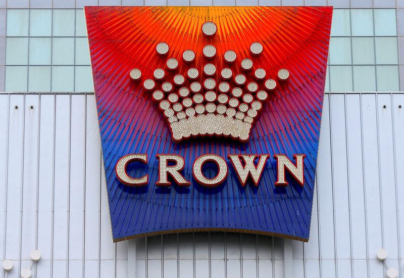 FILE PHOTO - The logo of Australian casino giant Crown Resorts Ltd adorns the hotel and casino complex in Melbourne