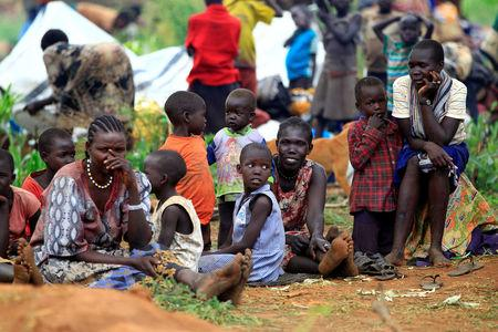 South Sudanese families displaced by fighting, queue for vaccination in Lamwo after fleeing fighting in Pajok town across the border in northern Uganda, April 5, 2017. REUTERS/James Akena