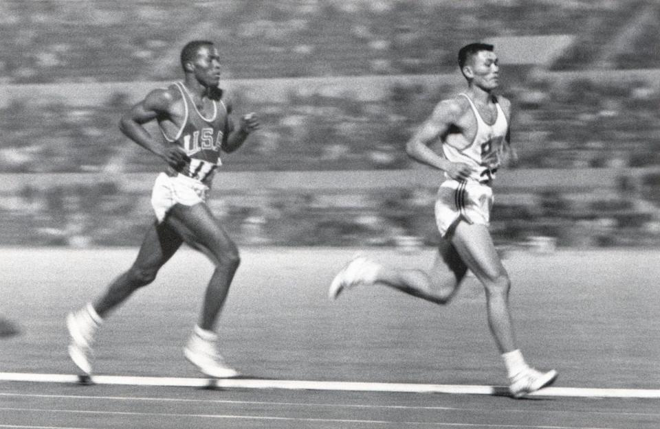 Rafer Johnson (left) competes against Yang Chuan-kwang in the 1500m event of the decathlon competition during the 1960 Summer Olympics in Rome. (PHOTO: Robert Riger/Getty Images)