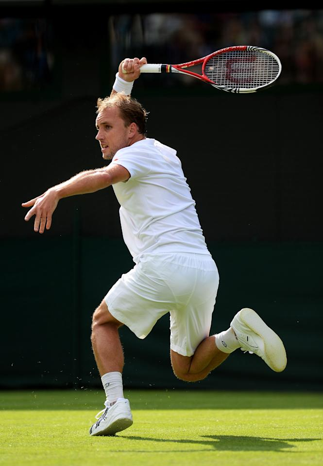 LONDON, ENGLAND - JUNE 24: Steve Darcis of Belgium hits a forehand during his Gentlemen's Singles first round match against Rafael Nadal of Spain on day one of the Wimbledon Lawn Tennis Championships at the All England Lawn Tennis and Croquet Club on June 24, 2013 in London, England. (Photo by Mike Hewitt/Getty Images)