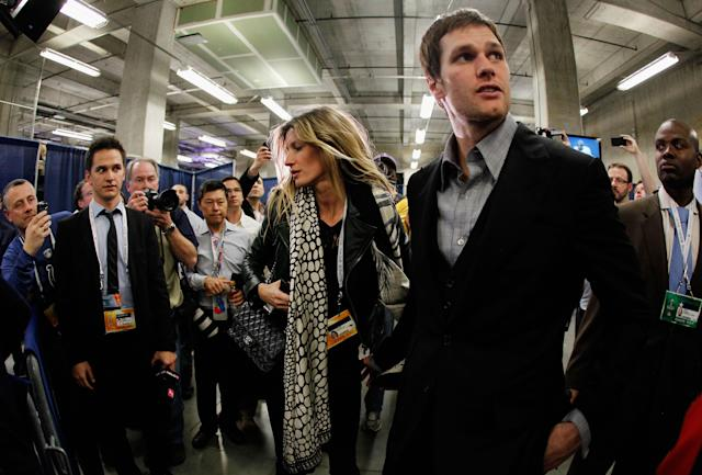 INDIANAPOLIS, IN - FEBRUARY 05: Tom Brady #12 of the New England Patriots walks with his wife Gisele Bundchen after losing to the New York Giants by a score of 21-17 in Super Bowl XLVI at Lucas Oil Stadium on February 5, 2012 in Indianapolis, Indiana. (Photo by Rob Carr/Getty Images)