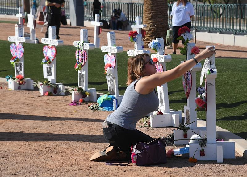 Ashley Schuck pays homage to the 58 victims of the Las Vegas massacre one year ago, the deadliest mass shooting in US history. (AFP Photo/Ethan Miller)