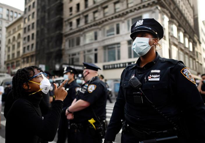 A protester confronts NYC police