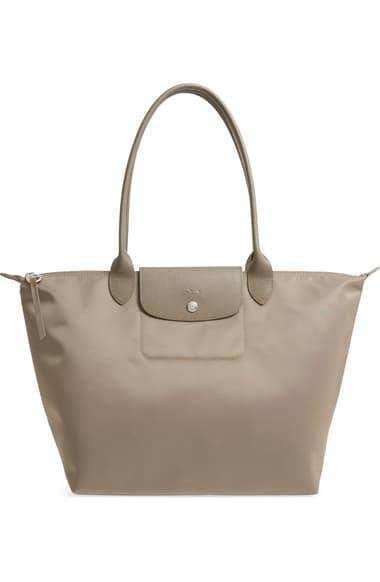 <p>You can fit so much in the <span>Longchamp Large Le Pliage Nylon Tote</span> ($190).</p>