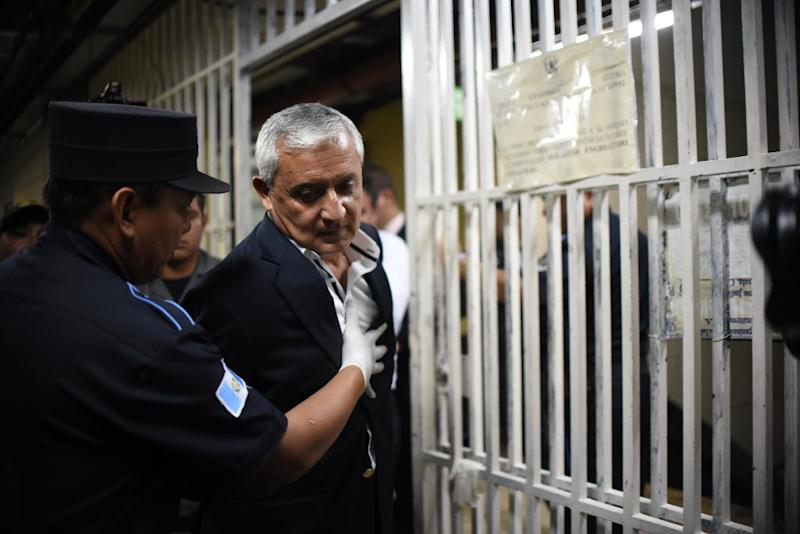 Guatemalan former president Otto Perez leaves the Supreme Court in Guatemala City on March 28, 2016 after the judge suspended the hearing in which he was to decide on whether a trial against Perez would take place