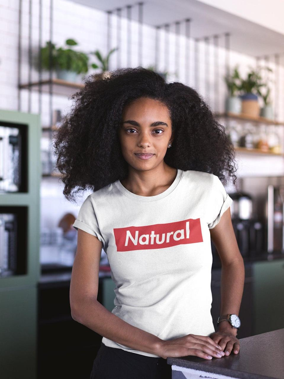 <p>Another shout-out to all the ladies who rock natural hair unapologetically. </p> <p><span>Ladies Tee: Natural</span> ($25)</p>