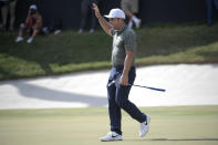 Francesco Molinari, of Italy, celebrates after sinking a putt for birdie on the 18th green during the final round of the Arnold Palmer Invitational golf tournament Sunday, March 10, 2019, in Orlando, Fla. Molinari won the tournament by two strokes. (AP Photo/Phelan M. Ebenhack)
