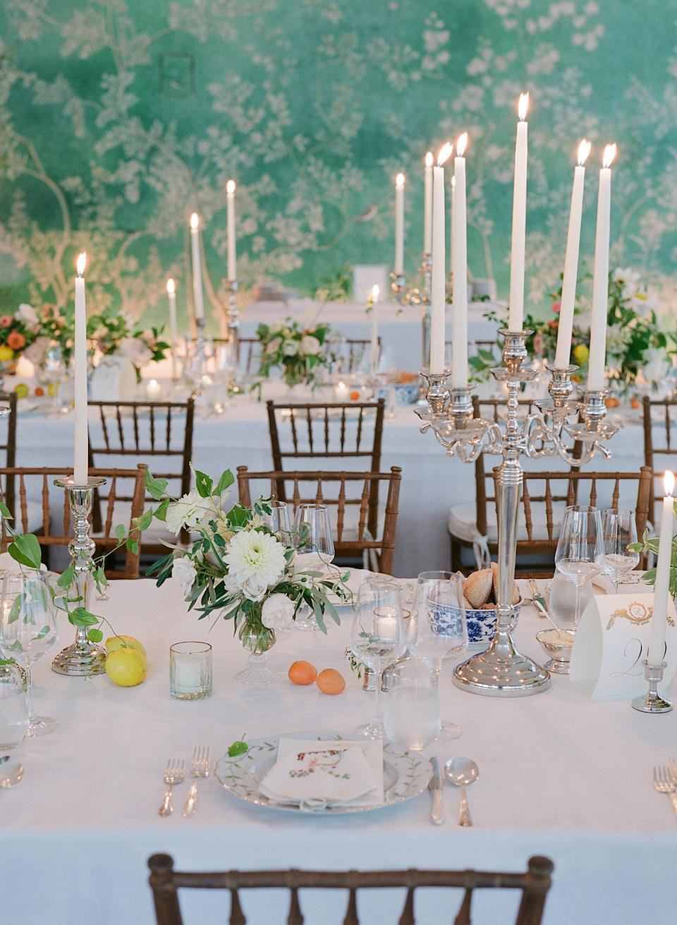 The dinner tables were filled with overgrown floral arrangements with pops of seasonal citrus fruits inspired by still-life paintings.