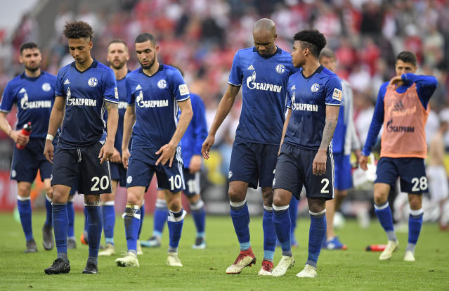 Schalke's players leave the pitch disappointed after the German Bundesliga soccer match between 1. FC Cologne and FC Schalke 04 in Cologne, Germany, Sunday, April 22, 2018. The match ended 2-2. (AP Photo/Martin Meissner)